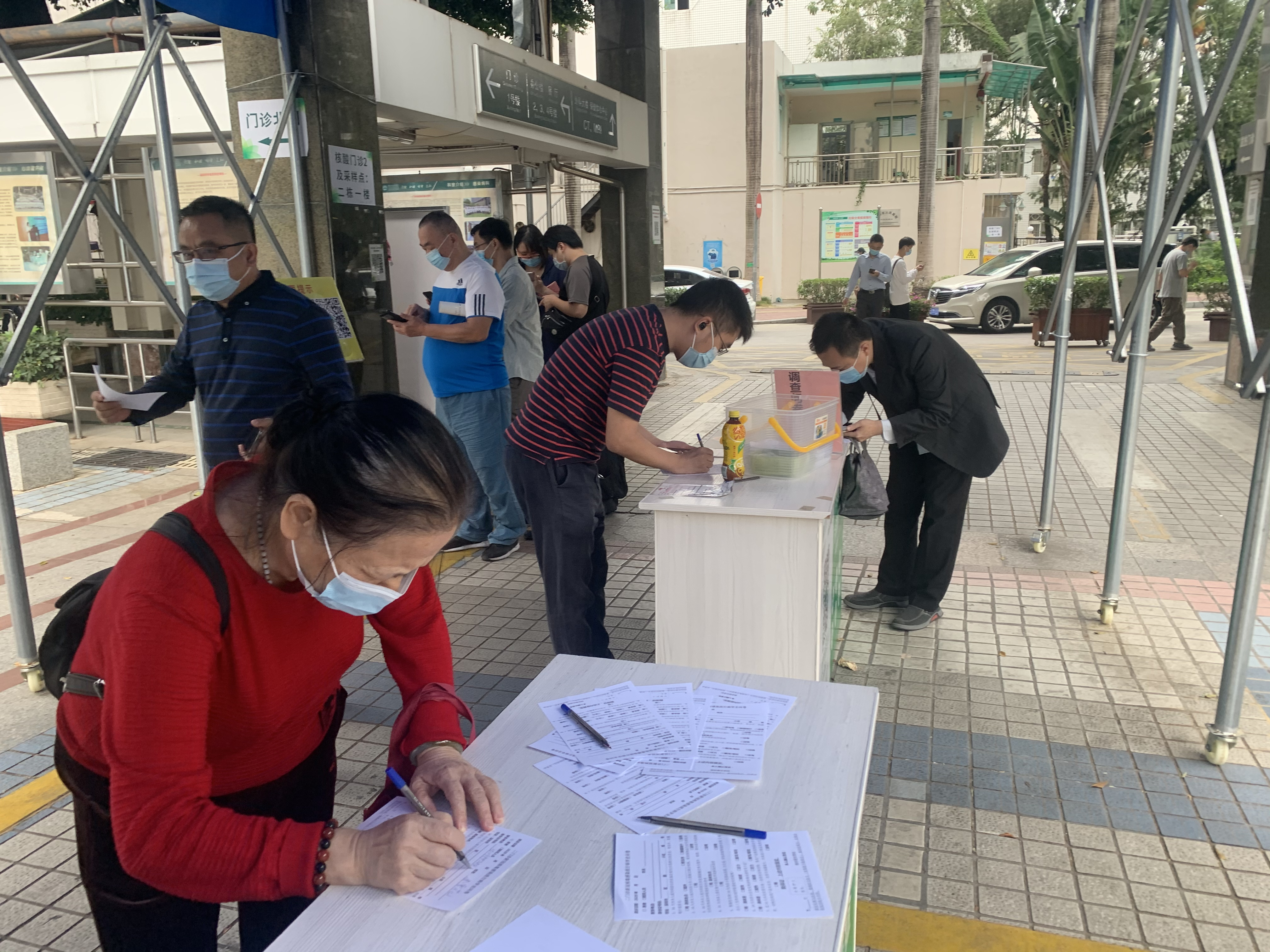 Patients fill out questionnaire before entering the hospital