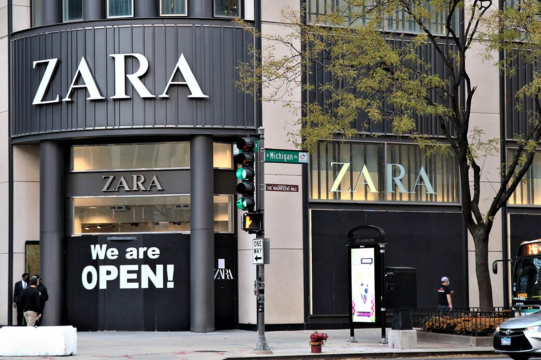 """The painted words """"WE ARE OPEN"""" greet ZARA customers"""