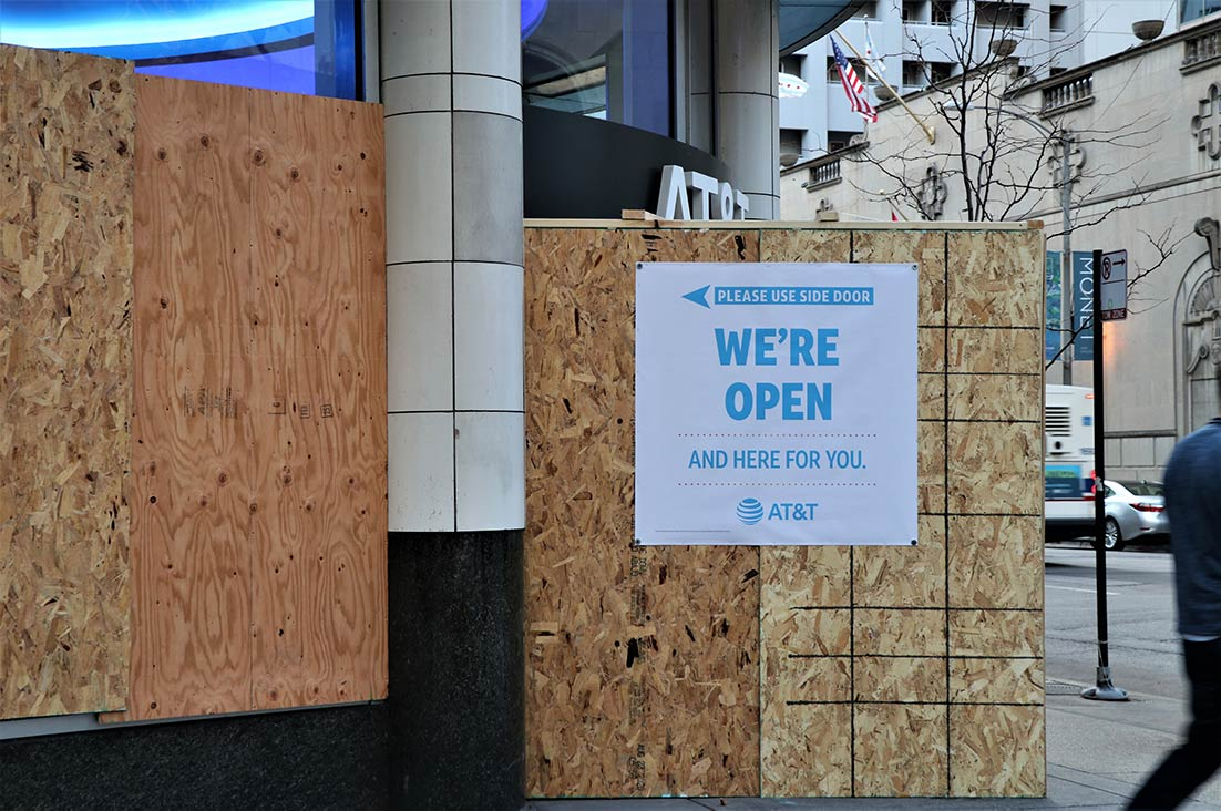 A boarded-up AT&T store