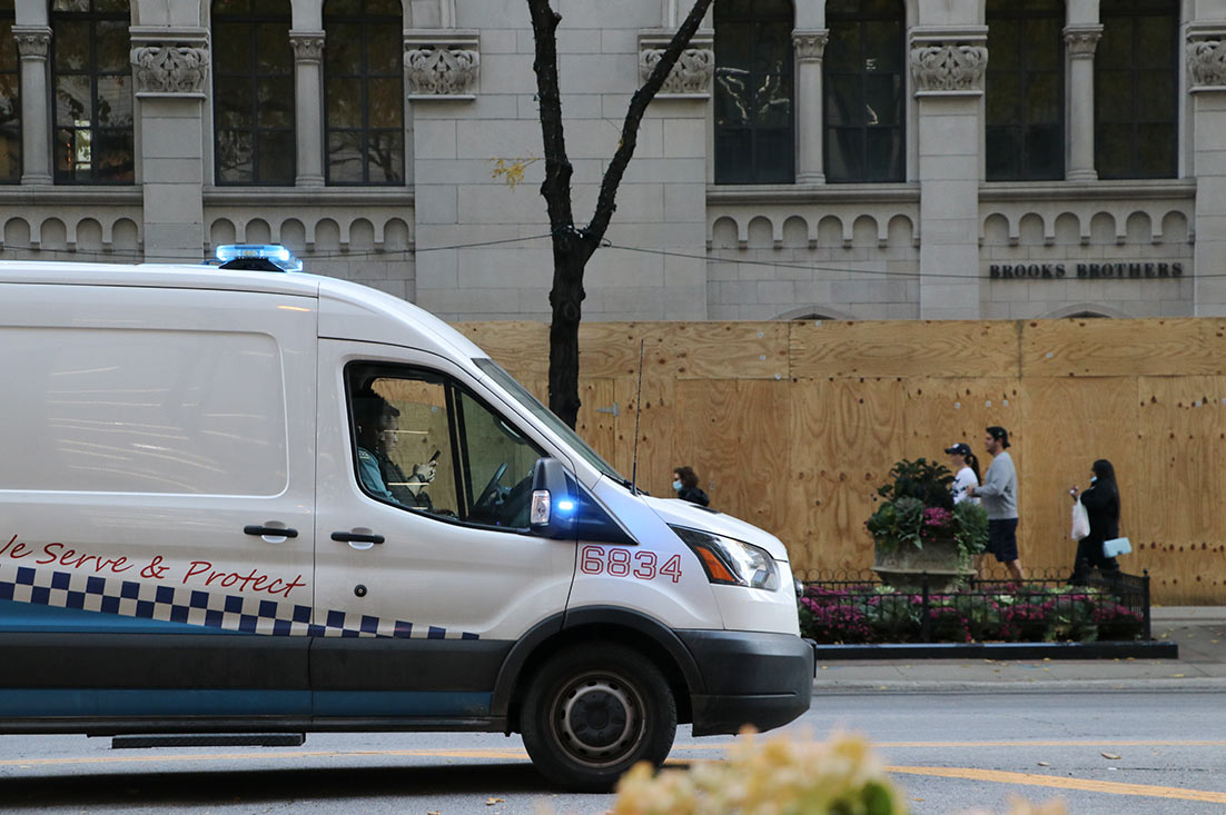 A Chicago Police Department vehicle parked along Michigan Avenue medians