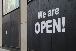 "The painted words ""WE ARE OPEN"" greet ZARA customers"