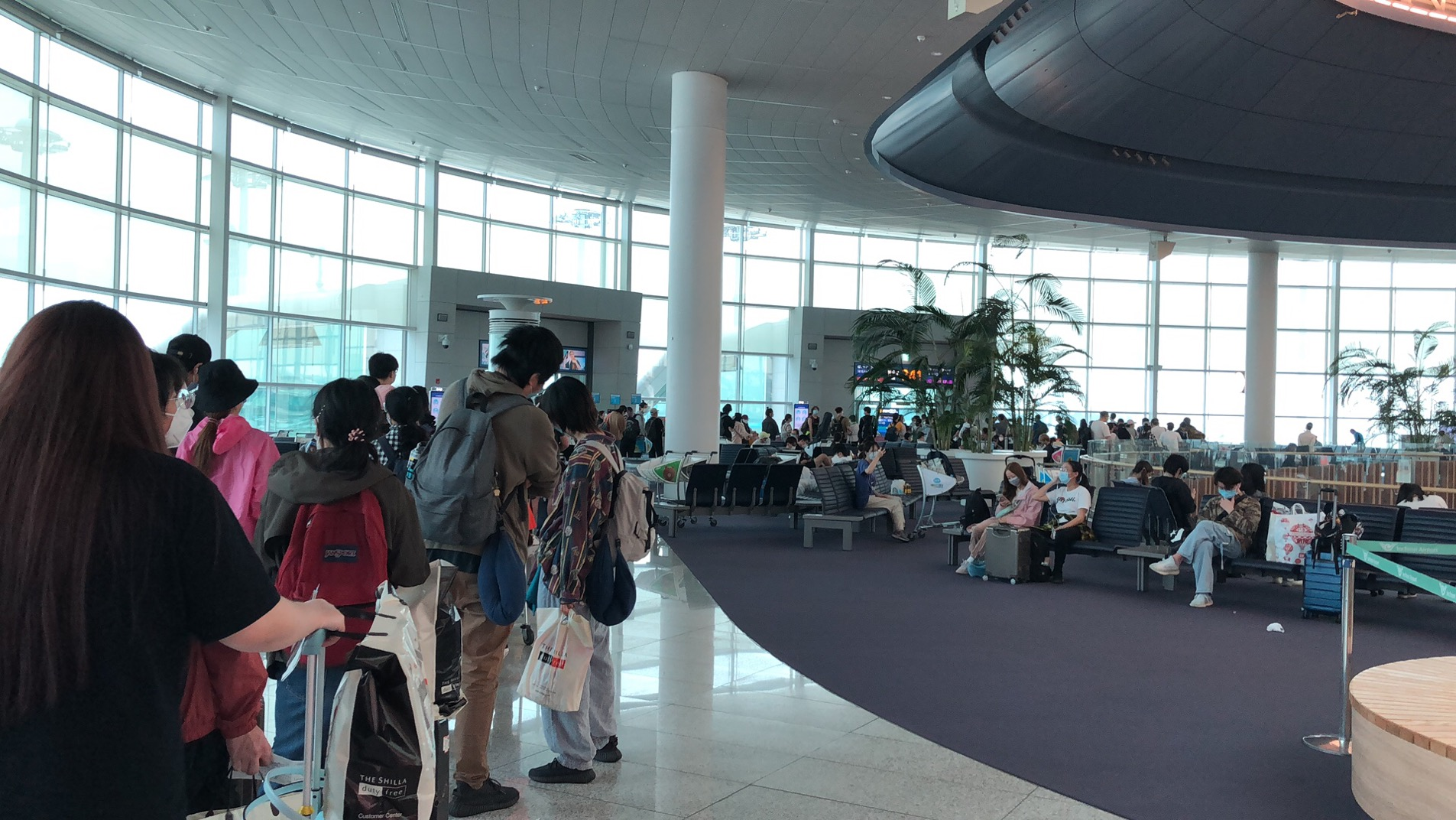 Passengers lined up and prepared to board the flight back to China.