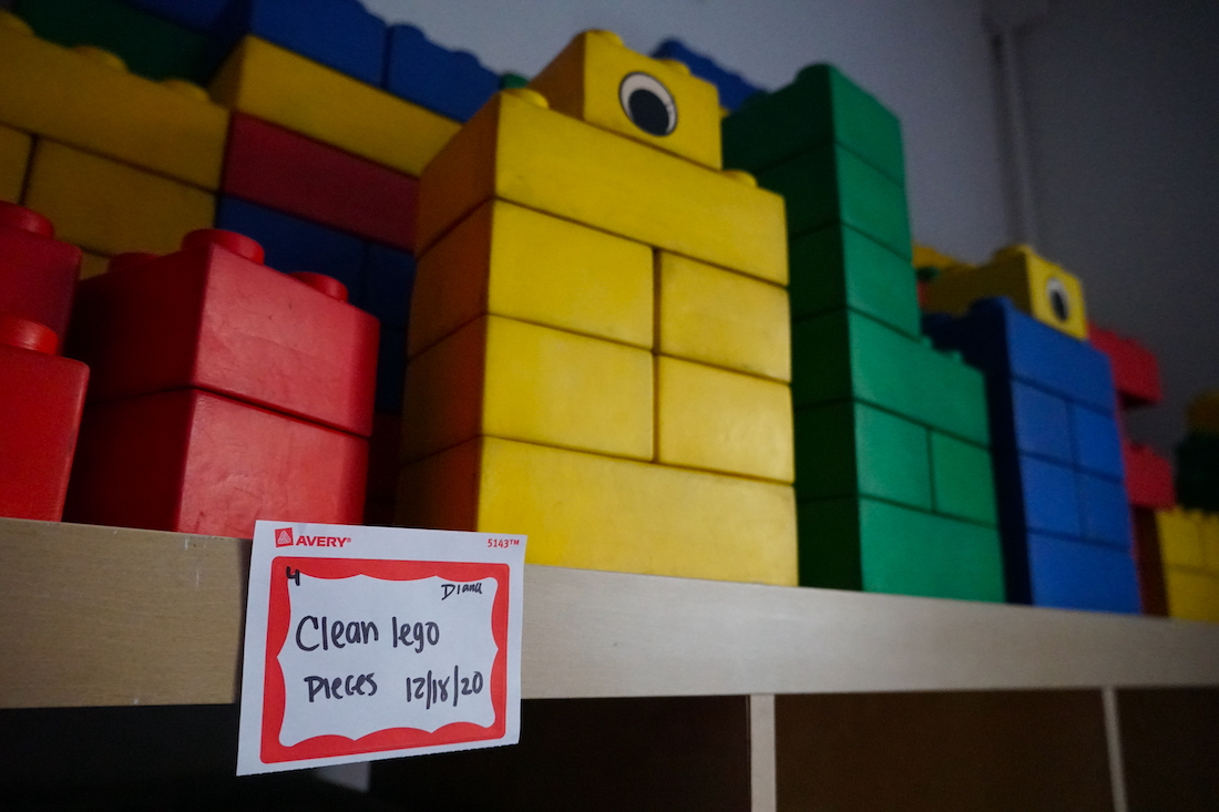 Toys, legos and enrichment materials are separated and labeled once they have been sanitized. The shelves of books that used to be available for students to take have been hidden away in staff offices. (Ester Wells/Medill)