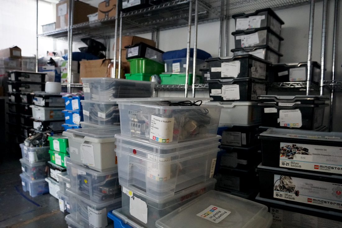 Storage bins full of enrichment tools, toys and educational manuals stack to the ceiling in now empty staff offices. (Ester Wells/Medill)