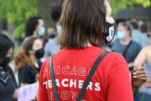 A woman wears a Chicago Teachers Union shirt as she attends The People's Report Card March. (Diamond Palmer/MEDILL)