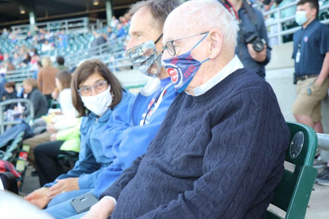 Iowa Cubs majority owner Michael Gartner watches an Iowa Cubs game from the stands at Principal Park on May 7, 2021.