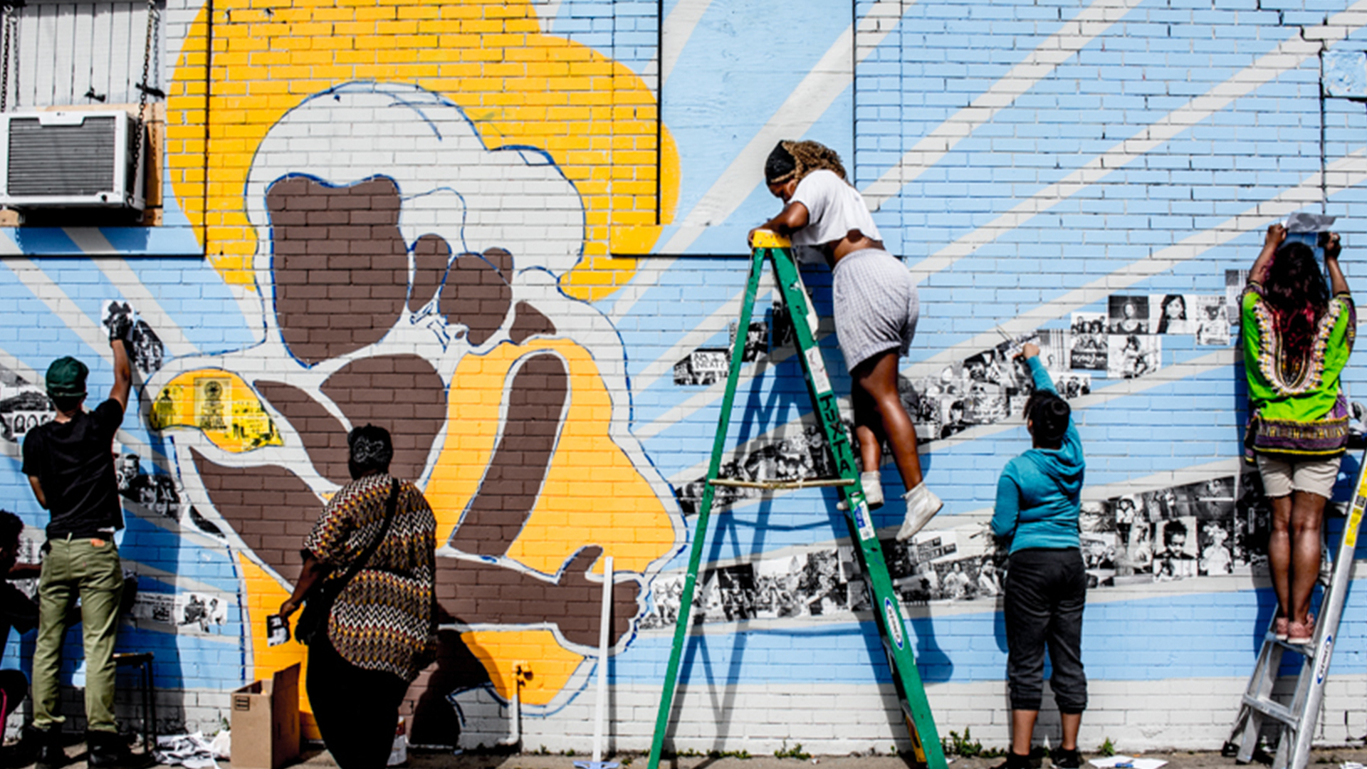 group creating a mural in north minneapolis