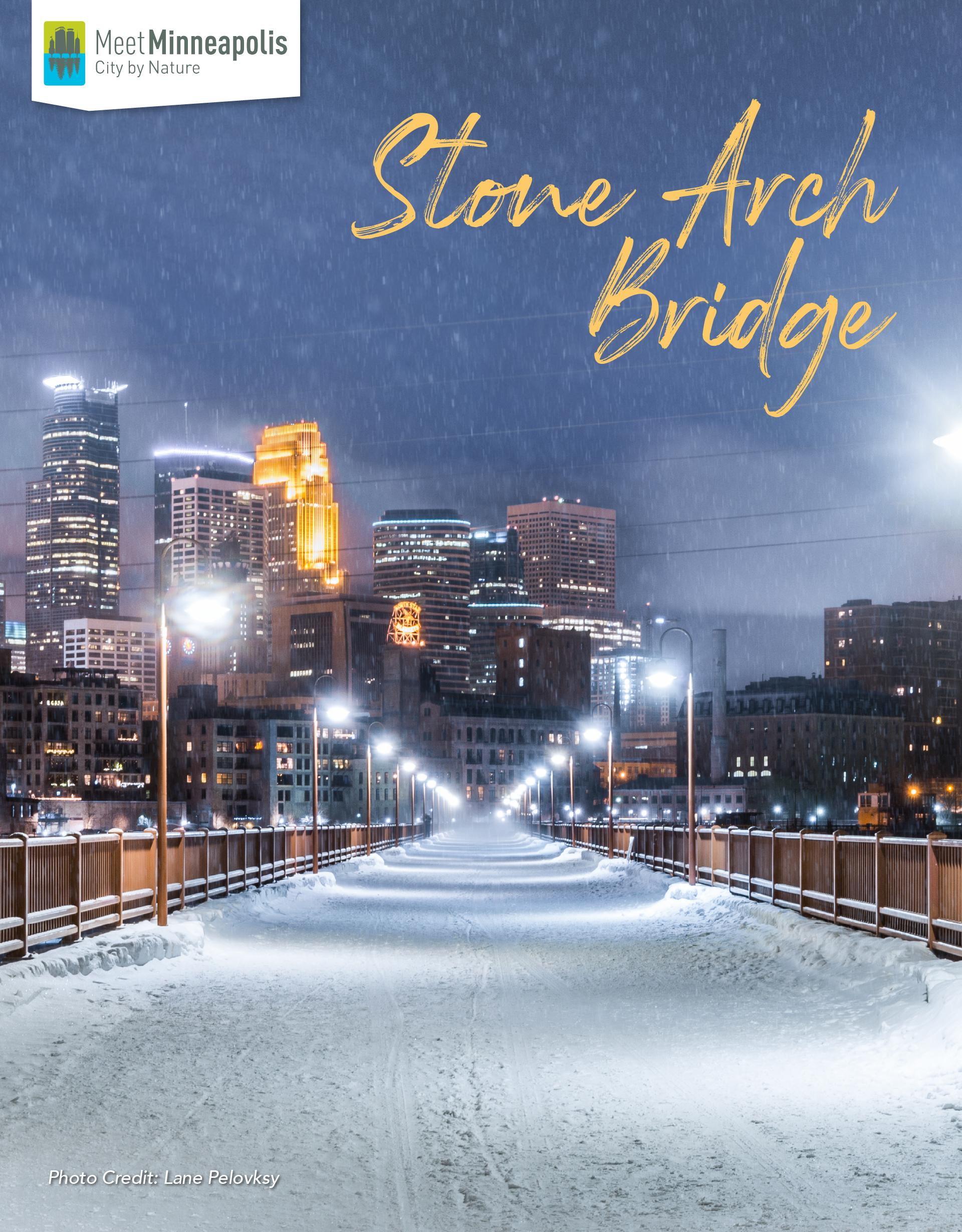 snowy stone arch bridge