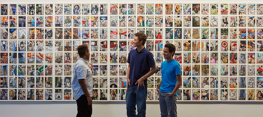 group of friends viewing artwork