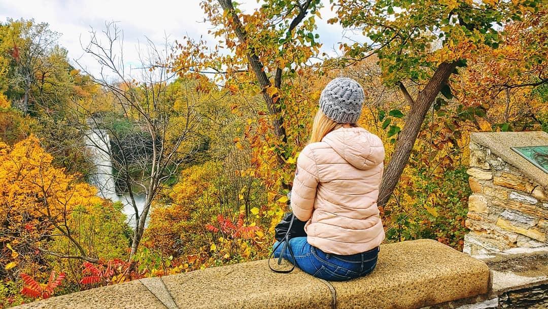 girl looking at minnehaha falls