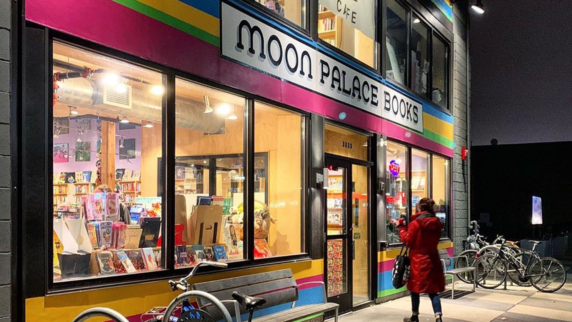woman entering moon palace bookstore