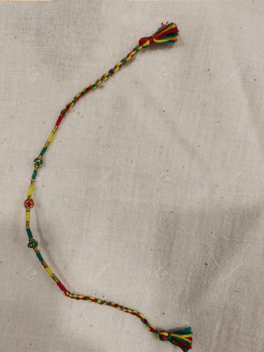 Multicolor Beaded Linear Handmade Rakhi by Guljibhai