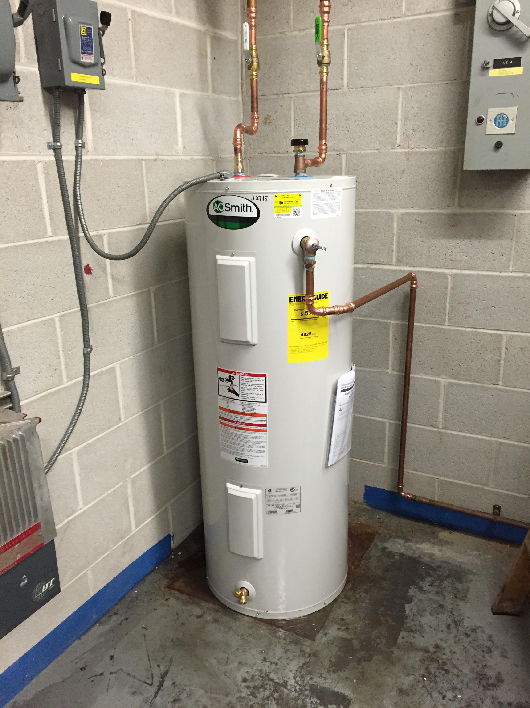 Hot water heater concrete floor gurus floor for Plastic hot water tank