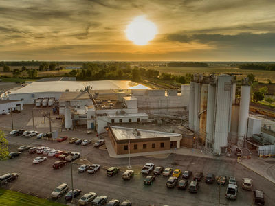 Sun sets in sky behind bakery mix plant