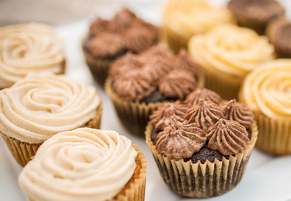 Cupcakes shown in different flavors, frosting