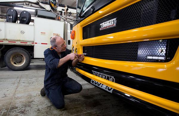 Mechanic works on school bus