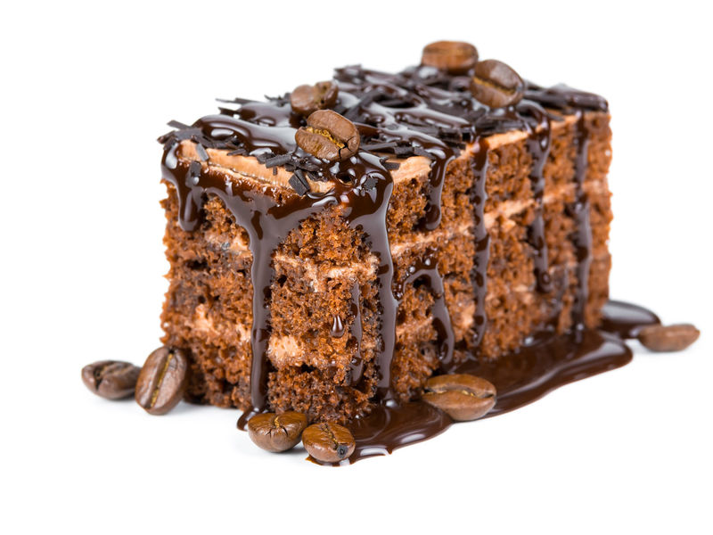 Generous slice of cake drizzled with chocolate syrup