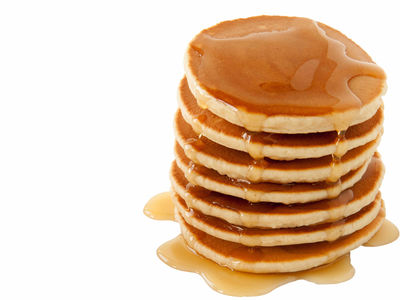 Stack of pancakes drizzled with maple syrup