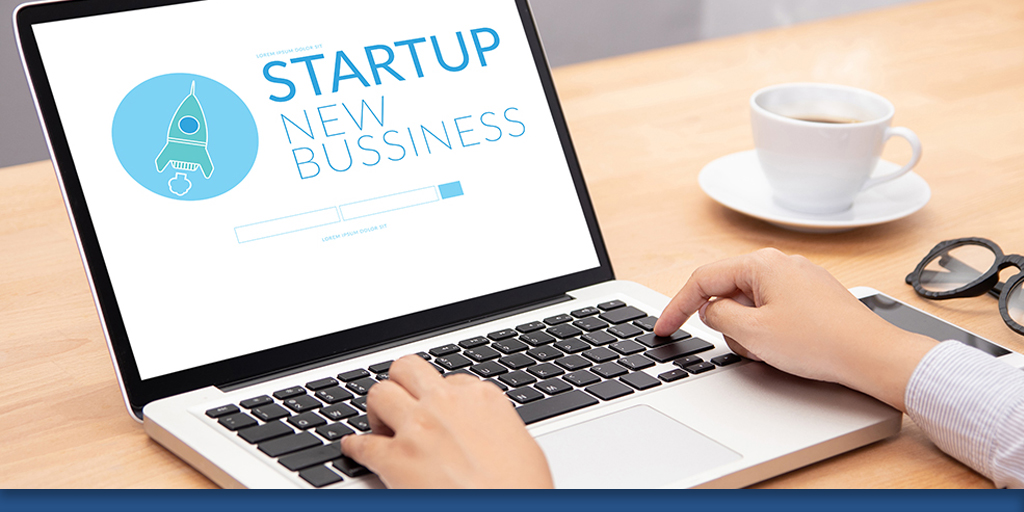 Startup business text on laptop
