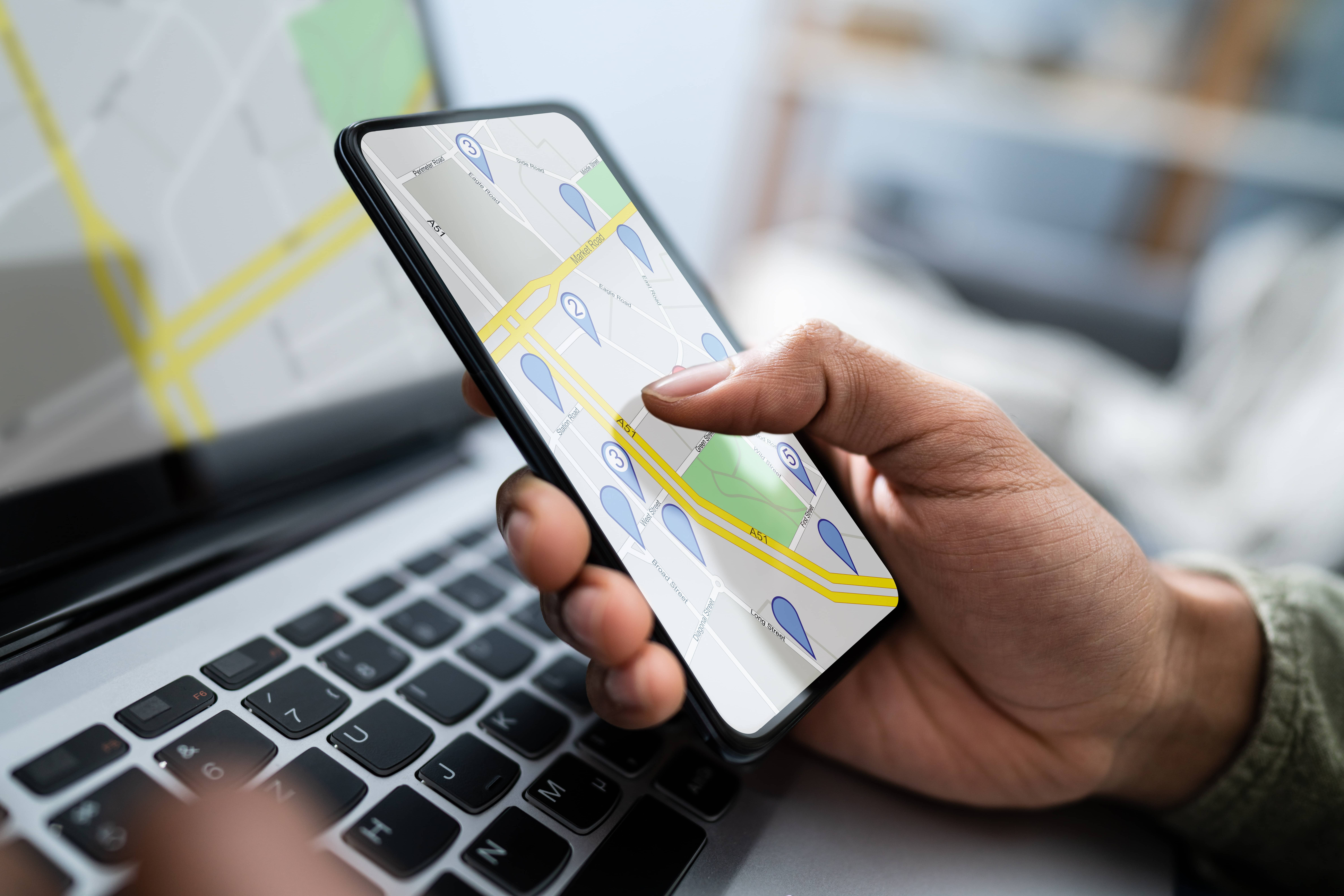 Person using the maps app on their cell phone