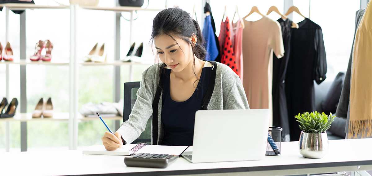 Asian woman business owner using resources from score