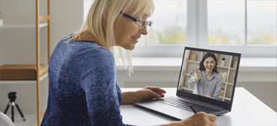 woman having a mentoring session on her laptop