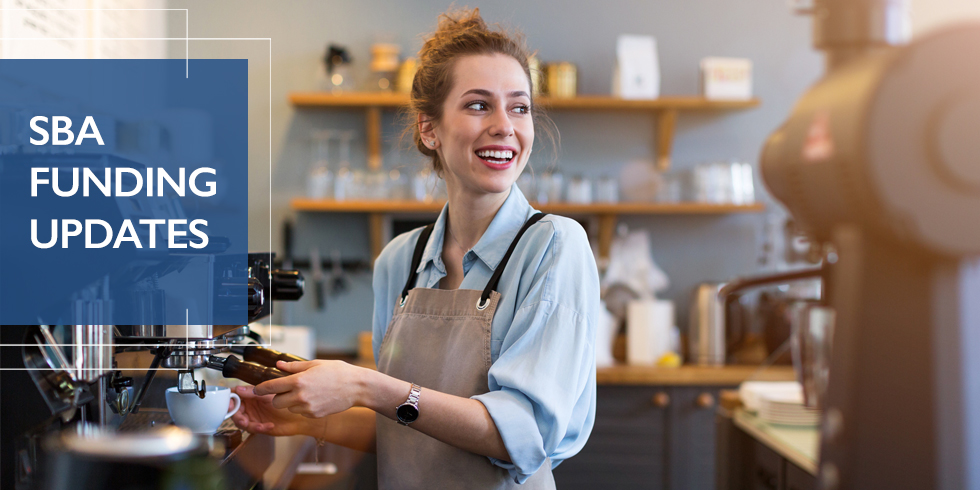 Young woman small business owner smiling while making a cup of coffee in her coffee shop