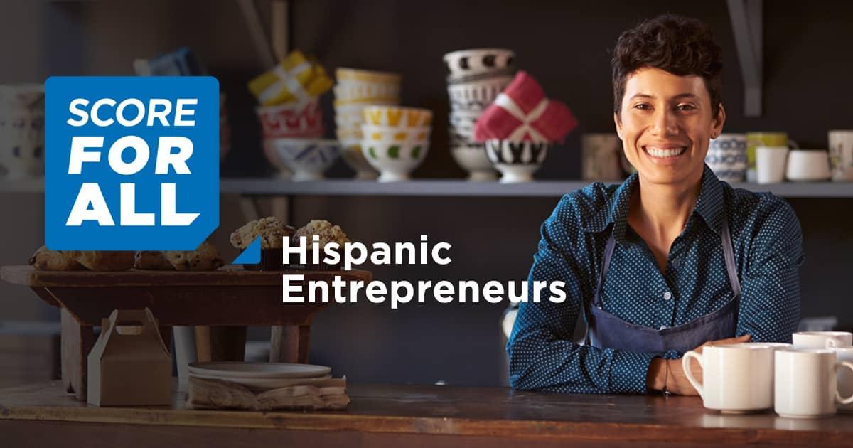 SCORE for Hispanic Entrepreneurs - Business owner in pottery shop smiling at camera