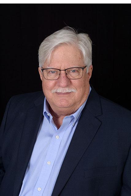 Neal J Becker