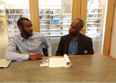 ASHTON ALEXANDER, FOUNDER OF ACCESS BERWYN, MEETS WITH KEITH COLEMAN, SCORE MENTOR & VICE CHAIR, DIVERSITY, SCORE CHICAGO, AT THE FOREST PARK PUBLIC LIBRARY