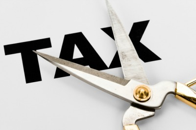 "Scissors cutting the word, ""Tax""."