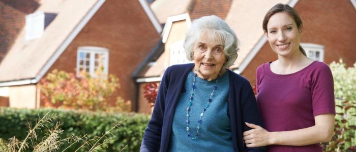 woman helping elderly woman