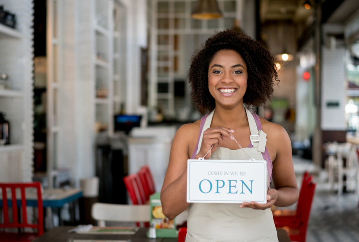 Women Holding Open Business Sign
