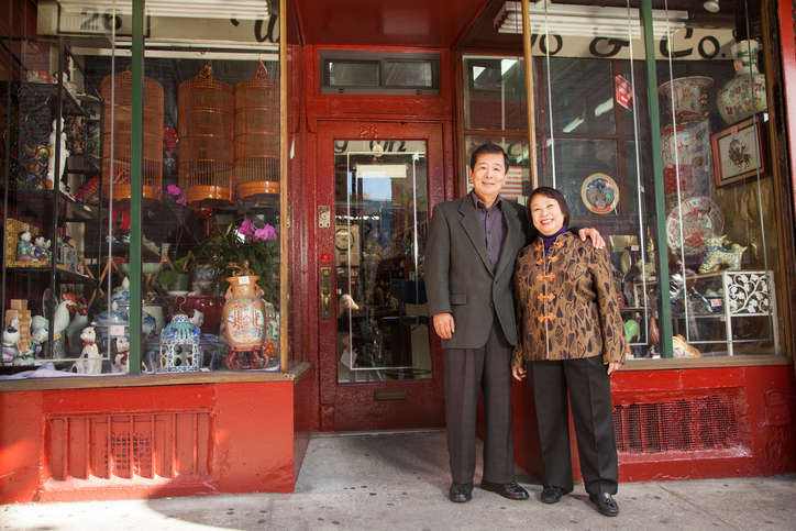 Asian couple in front of store
