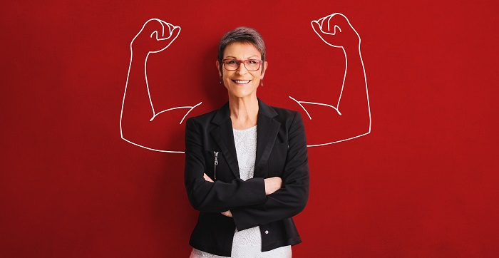 Confident-business-woman-against-red-backdrop