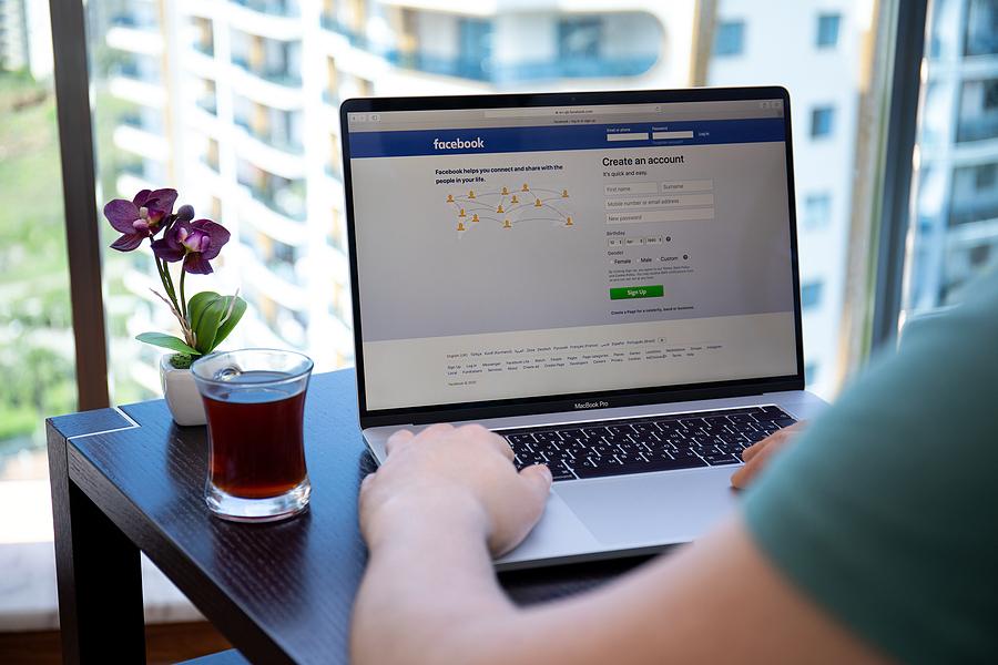 Man using facebook on his laptop