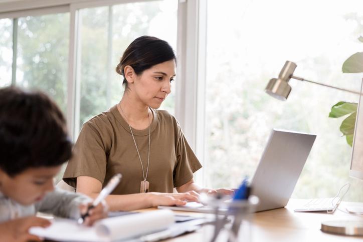 Female veteran sitting at a desk on her laptop