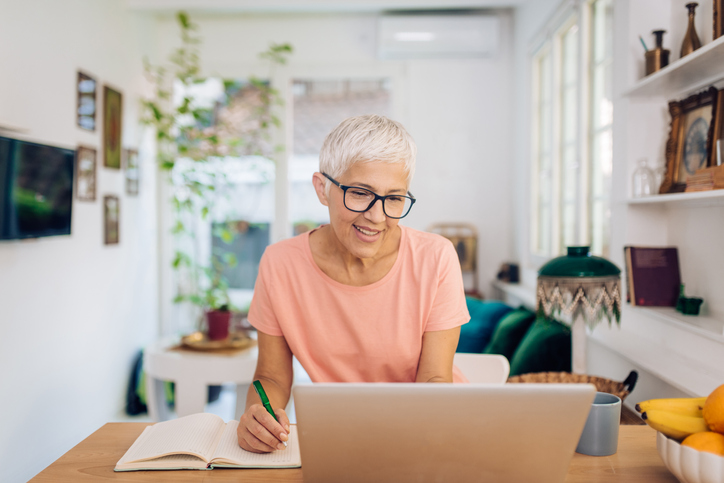 Elder business woman enhancing a business plan