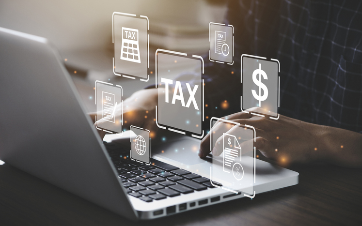 Person on a computer searching for tax information