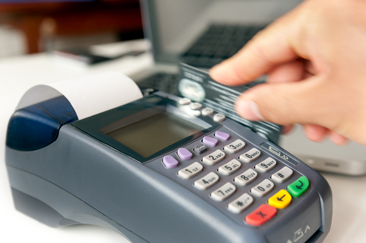 Credit card being processed in a handheld machine
