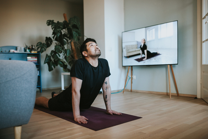 man watching fitness video online while at home