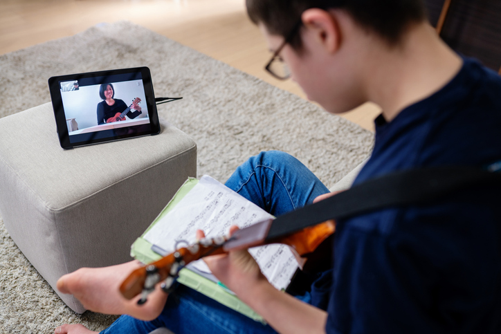 Online music lesson with boy and teacher