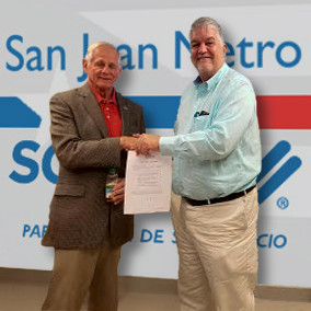 SCORE District Director Jerry Steinberg welcomes Frederic Chardon as Chapter Chair for San Juan Metro SCORE