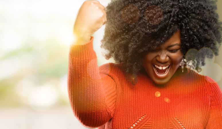 black-woman-celebrates-her-overcoming-challenges
