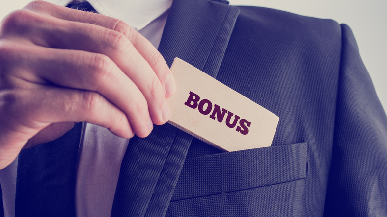 bonus in business man's pocket