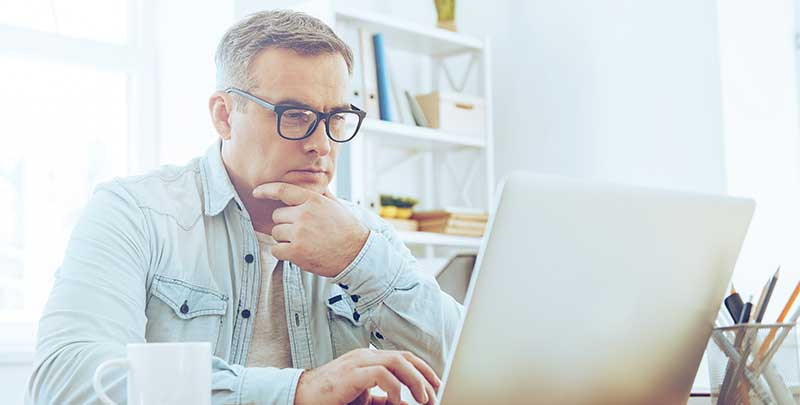 Man working on business plan at computer.