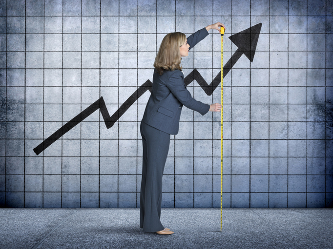 businesswoman measures growth on a chart