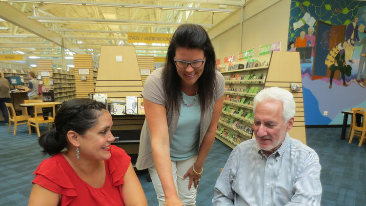 Katrina Davis-Salazar (left) and Paul Rosenstrock, Lead Mentor, are joined by Jessica Stalker, WNPL Adult Services Librarian