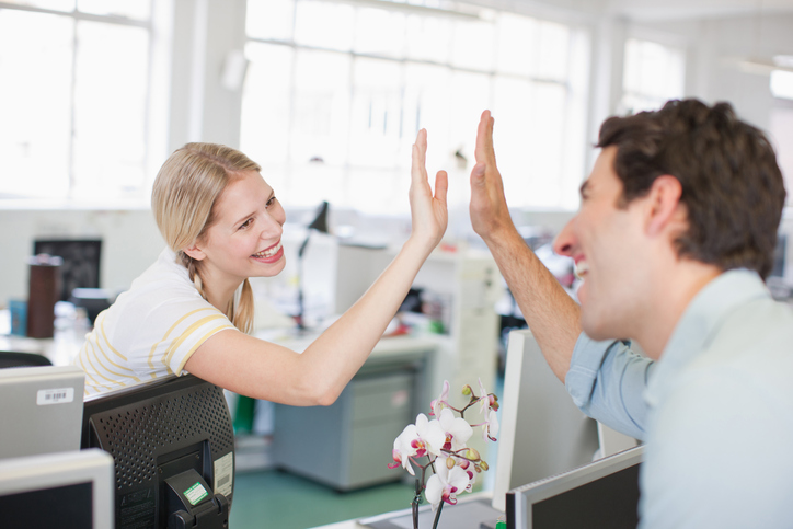 coworkers giving high five