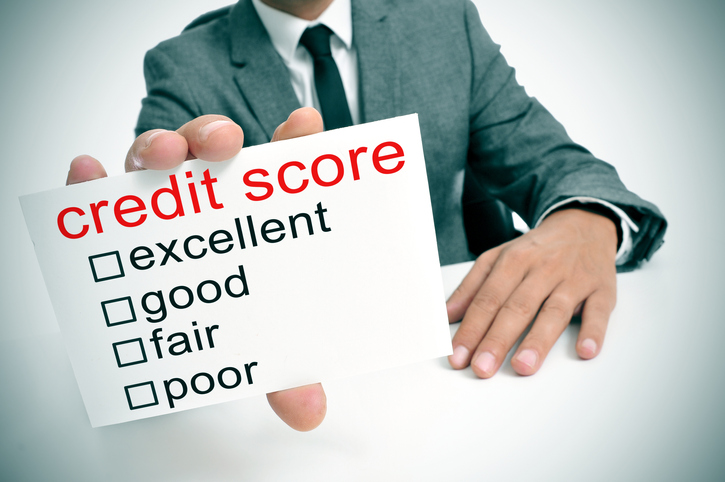 business man holds card with credit scores